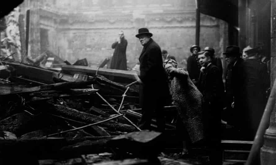 Winston Churchill and his wife inspect bomb-damage in London during the Blitz, 1940.