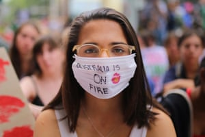 Sydney, Australia. A student activist takes part in a 'solidarity sit-down' protest outside the offices of the Liberal party