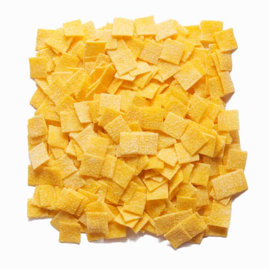 Quadrucci: square shape pasta on a white background, uncooked.