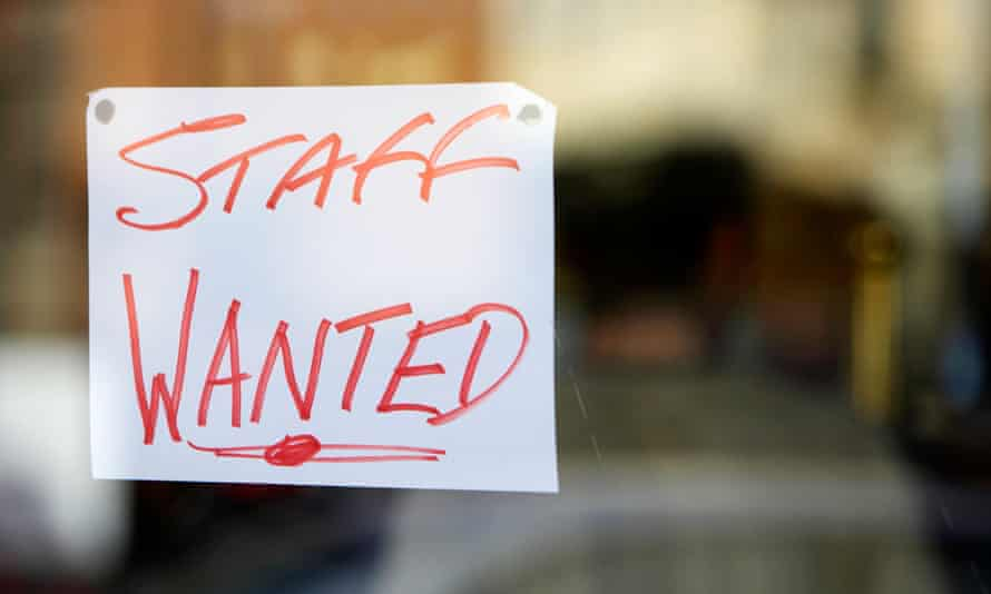 Staff wanted hand written sign in restaurant window in Belfast city centre