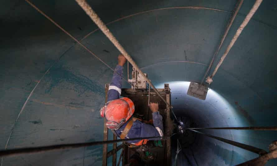 An engineer works on a giant pipe at the Jaguari dam, which will create an 11-mile link to the Cantareira system.