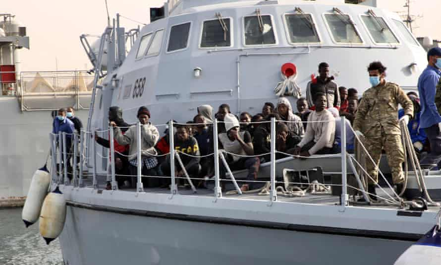 Immigrants on a Libyan coastguard ship in Tripoli.