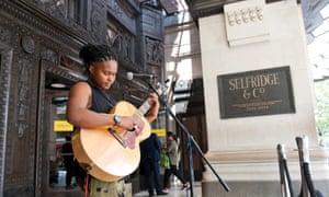 'Joyful experience' … Sherika Sherard busking outside Selfridges in Oxford Street, London, on 16 June.