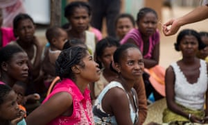 A doctor shows women an IUD while educating them about reproductive health and their family planning options at the Marie Stopes International mobile clinic in Besakoa, Madagascar.