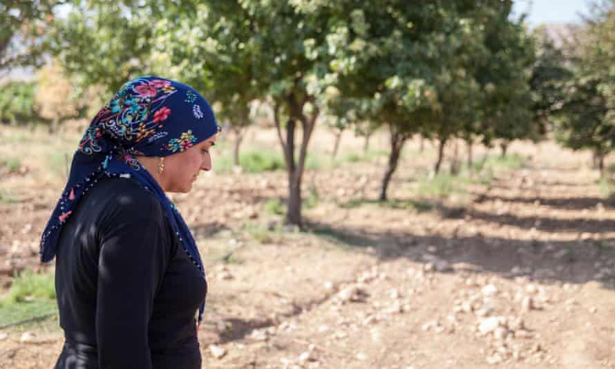 Hasankeyf resident Hediye Tapkan, 38, and her family's soon-to-be submerged fig groves.