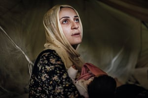 Taimaa, 24, with her baby in a refugee camp in Thessaloniki, Greece, September 2016