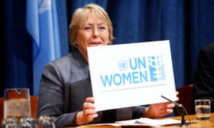 Michelle Bachelet, executive director of newly-created UN Women, holds up a sign for the organisation during a press conference on UN Women priorities for 2011.