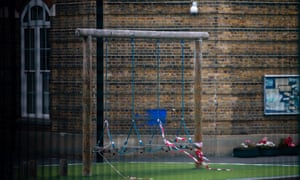 Children's playground equipment is cordoned off in the playground at the temporarily closed Hatcham Temple Grove school in London