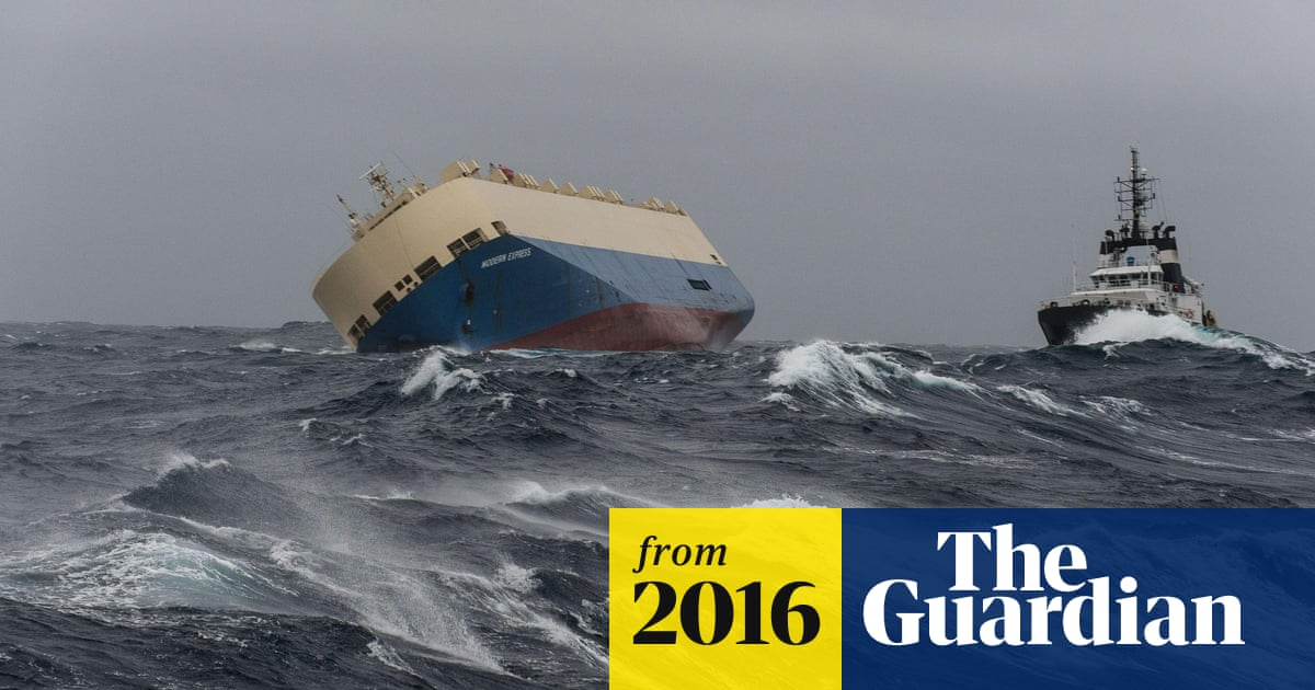 Drifting, unmanned cargo ship is towed away from French