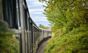 Train runs past trees