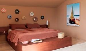 A bedroom in earthy tones.