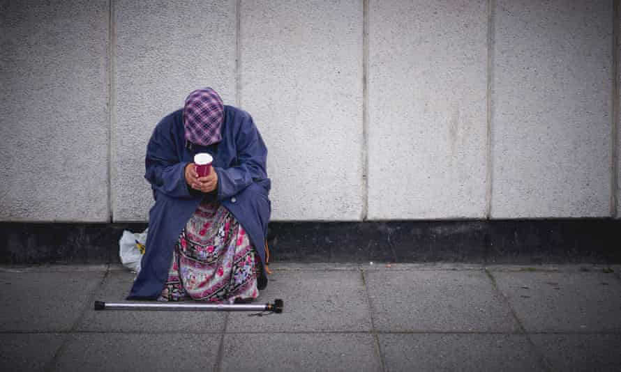 A woman begs in central London.