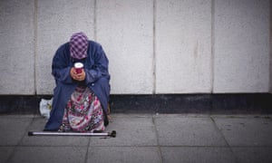 A woman is seen begging in London.
