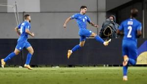 Manor Solomon (C) of Israel celebrates after scoring.