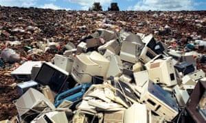 Computers dumped on landfill site: the safe disposal of electronic rubbish like computers which will contaminate the earth land fill computer