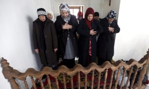 Bosnian Muslim women pray at the reconstructed mosque.