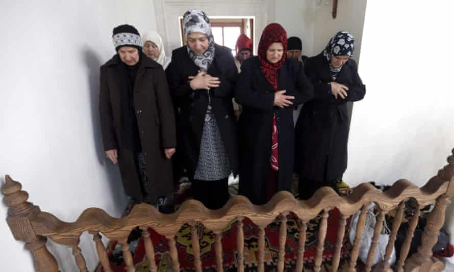 Bosnian Muslim women pray at the reconstructed mosque.