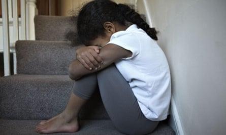 Sad girl on stairs