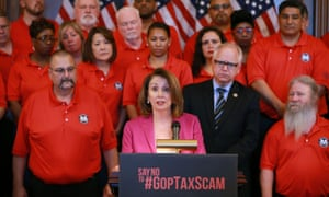 Nancy Pelosi with members of the Machinists Union International campaigning against the Republicans' tax cut legislation this week.