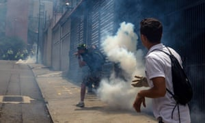 Demonstrators clash with police during a protest against Nicolás Maduro's government in Caracas, Venezuela.
