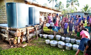 People queue to use the Pak Flat water tank in the Itokama region of Papua New Guinea.