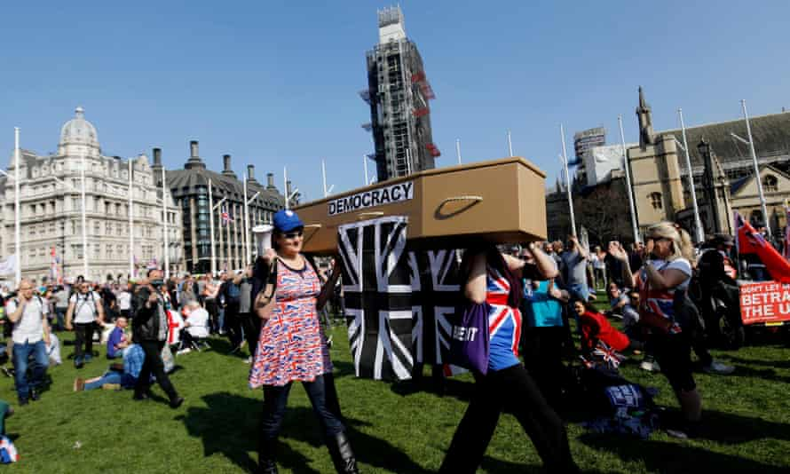 Pro-Brexit protesters carry a coffin of democracy in Parliament Square.