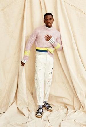 Jumper, striped top, cumberbund, painted trousers, socks, and sandals, all dior.com