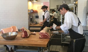 Aaron Rocchino butchers meat inside his shop, which partners with local farmers and offers classes.