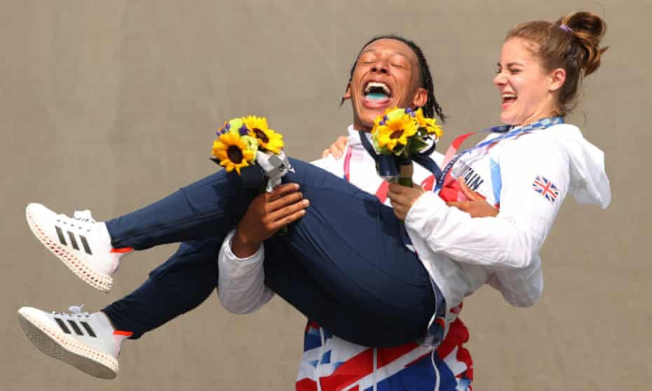 BMX silver medalist Kye Whyte and gold medalist Bethany Shriever of Team GB celebrate at the medal ceremony after the BMX final in Tokyo.