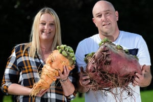 Laura and Chris Marriott pose with their winning carrot at 3.8kg and beetroot at 17.84kg