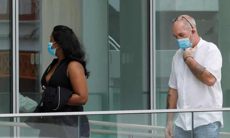 Nigel Skea and his wife Agatha Maghesh Eyamalai arrive in court in Singapore