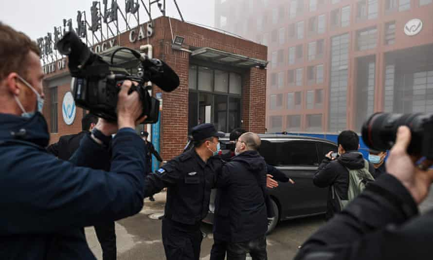 The WHO team arrive at ghe heavily guarded Wuhan Institute of Virology on Wednesday.