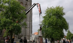 The statue of Belgian king Leopold II being removed by local authorities in Antwerp.