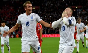Harry Kane celebrates with the then England captain Wayne Rooney after the latter breaks the country's scoring record against Switzerland in 2015.