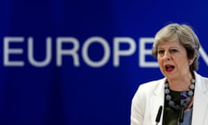 Theresa May addresses journalists during the EU summit in Brussels.