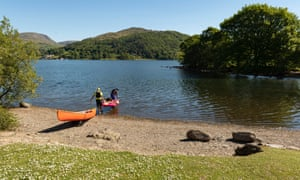 Two people Canoeing on Windermere from Low Wray Campsite.