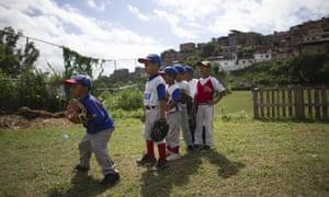 A young baseball player prepares to catch a ball during a practice at Las Brisas de Petare Sports Centre, Caracas, Venezuela