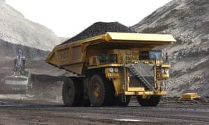 A mining dumper truck hauls coal.