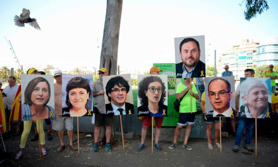 14 July 2018: Pictures of the Catalan leaders Carme Forcadel, Anna Gabriel, Carles Puigdemont, Marta Rovira, Oriol Junqueras, Jordi Turull and Clara Ponsati are held up by pro-independence protesters in Barcelona.