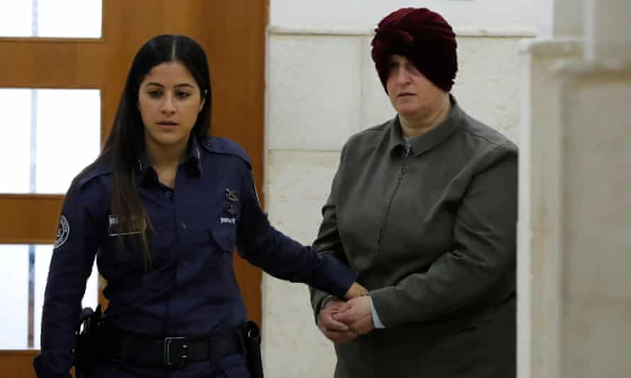 Malka Leifer, a former Australian teacher accused of dozens of cases of sexual abuse of girls at a school, arrives for a hearing at the district court in Jerusalem, Israel.