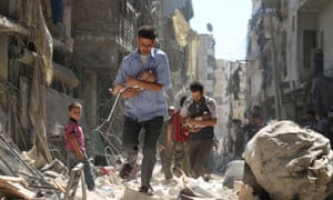 Men carry babies through rubble in Aleppo