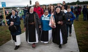 Nuns arrive ahead of a papal mass