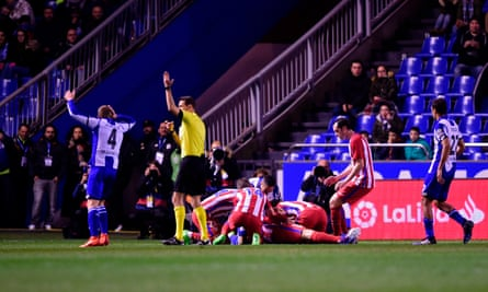 Atlético Madrid players crowd around Fernando Torres after he was knocked unconscious against Deportivo La Coruna on 2 March.