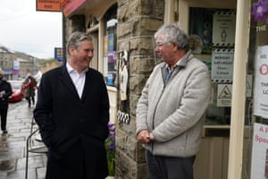 Sir Kier Starmer talking to a shopkeeper whilst campaigning in Rossendale, Greater Manchester, today.