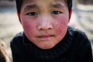 """A six-year-old boy in Chek village, Batken Oblast whose parents divorced after they left to work in Russia. A fifth of <a href=""""http://www.theguardian.com/world/2014/jun/09/-sp-post-soviet-world-need-to-know-kyrgyzstan"""">Kyrgyzstan</a>'s population work abroad with money sent home accounting for more than a third of the country's GDP"""