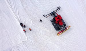 Workers lay out huge geotextile sheets on the Presena glacier in northern Italy.