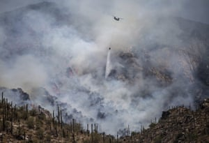 A chinook helicopter drops a load of water on the Bighorn Fire in Tucson, Arizona, last month.