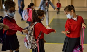 Children wearing face masks enter the Luis Amigó school in Pamplona, Spain, on Monday as students in five regions return to class for the first time in six months.