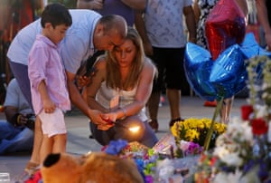 Well-wishers light candles at a makeshift memorial in Dallas