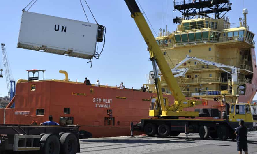 A container holding bodies of migrants is unloaded from the Norwegian ship Siem Pilot at the port of Catania.